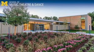 Zoom background, exterior of Brehm Pavilion in spring with pink flowers
