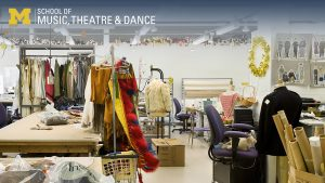 Zoom background, Walgreen Drama Center costume shop showing fabric, workstations, and costumes