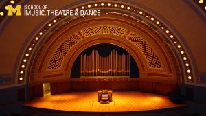 Zoom background, Hill Auditorium stage with organ console centered, view from the audience