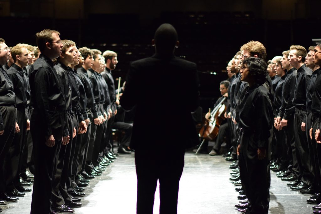Eugene Rogers stands in front of the U-M Men's Glee Club