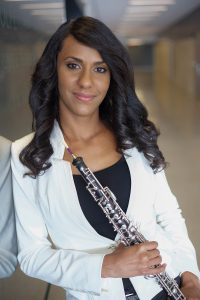 Nermis Mieses holding her oboe