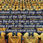 Photo of chairs with SMTD shirts on them and a quote about SMTD's stand against racism