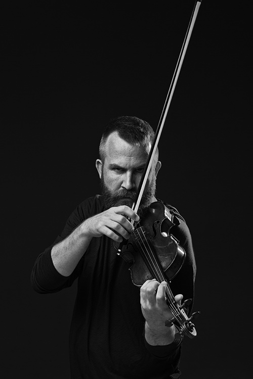 Matt Albert playing viola, black and white photo by RR Jones.