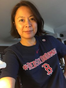 Casual photo of Christi-Anne Castro wearing a navy blue with red and white lettering, Boston Red Sox t-shirt.