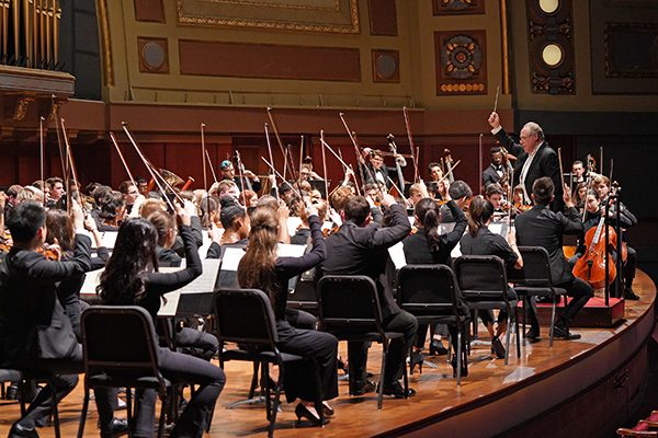UMSO students and Prof. Kenneth Kiesler playing onstage at Hill Auditorium